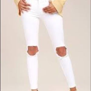 Free People white busted knee jeans.